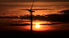 Wind energy, wind turbine at sunset Stock Footage
