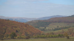 Aerial background with mountains in fall season. Autumn beginning. - stock footage