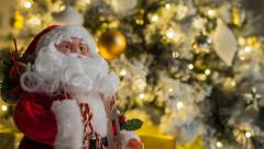 Santa Claus beside a  Christmas tree Stock Footage