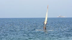 Summer wind surfing at ocean horizon at daytime Stock Footage