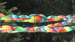 Playground decorated with colorful umbrellas in a park. Vacation in a hot summer Stock Footage
