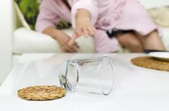 fallen glass on white table - stock photo