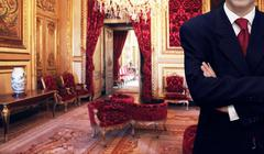 staff man standing inside luxury royal palace interior - stock photo