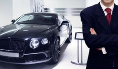 Car dealer presenting vehicle in showroom store Stock Photos