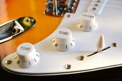 tone and volume knobs - stock photo