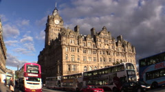 Scotland. Edinburgh, Balmoral Hotel Time Lapse Clouds, cars, buses Stock Footage