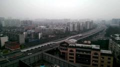 Chinese cityscape and highway in a severely air polluted day ,Chengdu, Sichuan Stock Footage