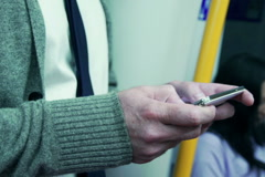 Man riding in metro and texting on smartphone, steadycam shot Stock Footage
