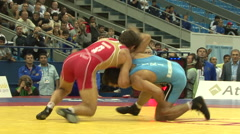 Freestyle wrestler rolls another wrestler 02 Stock Footage