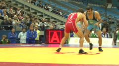 Freestyle wrestler rolls another wrestler 03 Stock Footage