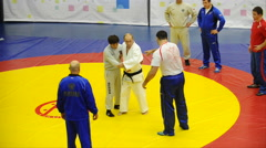 Putin in a kimono in training rolls - stock footage