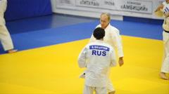 Putin in a kimono in training rolls 02 Stock Footage