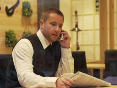 Stock Video Footage of Businessman calling about advertisement found in  the gazette, steadycam shot