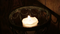 Burning candle in the dark Stock Footage