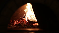 Pizza baking in a wood fired oven Stock Footage