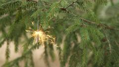 Sparkler is burning in christmas tree (rack focus) - stock footage