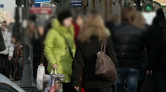 Passers-by (artificially blurred faces) on the street in autumn Stock Footage