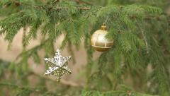decorative star an ball hanging in christmas tree (rack focus) - stock footage