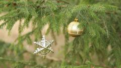 decorative satr and ball hanging in christmas tree (panning) - stock footage