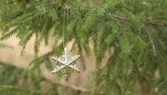 decorative star hanging in christmas tree (rack focus) - stock footage