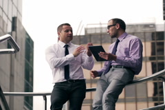 Businessmen having quarrel and using tablet Stock Footage