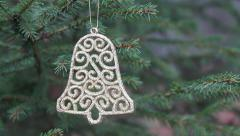 Decorative bell hanging in christmas tree (rack focus) Stock Footage
