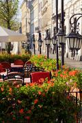 street cafe in cracow with tables and chairs - stock photo