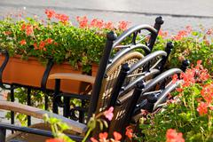 Town market cafe in cracow with tables and chairs Stock Photos