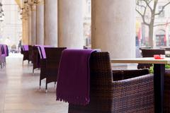 town market cafe in cracow with tables and chairs - stock photo