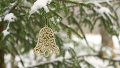 Decoartive bell hanging in christmas tree (panning) Stock Footage