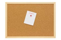 Urgent note on a pinboard Stock Photos