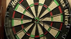 dart board with darts stick (right) - stock footage