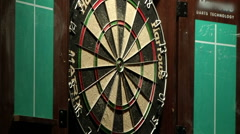 Dart board with darts stick Stock Footage