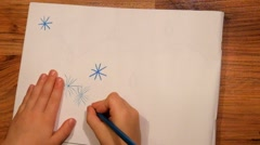 Close up view to drawing of child on paper. Drawing of blue star with pencil. Stock Footage
