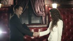 Business partners men and women doing a handshake. Slow motion Stock Footage