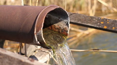 Clean water flows from a rusty pipe Stock Footage