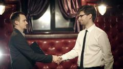 Business partners men and women doing a handshake. Slow motion. - stock footage