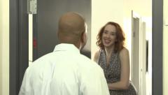 An interracial couple meet and leave on a date Stock Footage