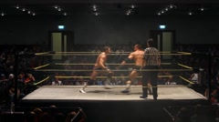 Pro Wrestling Match - Clothesline - Static Shot Stock Footage