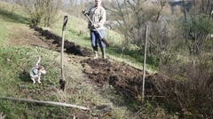 Young Gardener finished working in the garden with spade - stock footage
