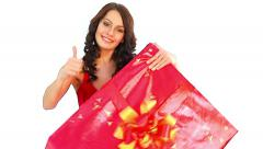 Woman with big gift box thumb up - stock footage