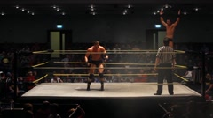 Pro Wrestling Match - Spinebuster in Ring - Static Shot Stock Footage