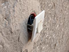 Bad electrical wiring in rural Moroccan town - stock photo