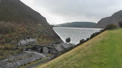 Stock Video Footage of Caban Coch Dam and turbine houses, Elan Valley, Wales