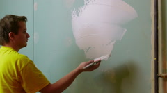 Construction Worker Applying Plaster on a Drywall - stock footage