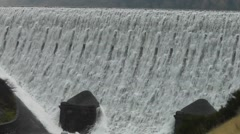 Stock Video Footage of Close-up of overflowing Caban Coch Dam, then zoom out