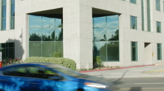 ESTABLISHING SHOT OF MODERN OFFICE BUILDING EXTERIOR . LARGE. TILT UP Stock Footage