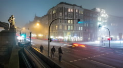 4K foggy crossroad with traffic lights by night in downtown - DSLR timelapse Stock Footage