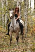 Stock Photo of young girl with appaloosa horse in autumn