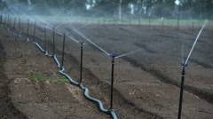 Irrigation system on farm - stock footage